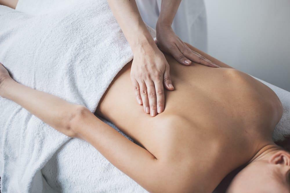 Woman receives a massage at knoxville spine and sports for a stiff neck.