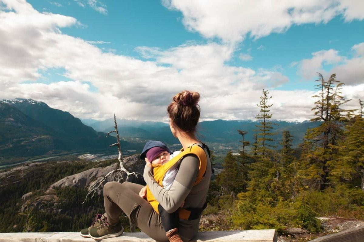 Mom with baby in mountains uses chiropractor to help