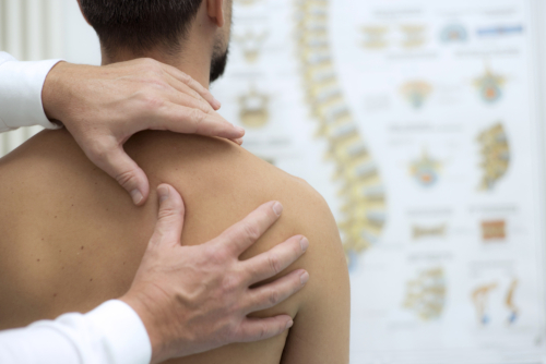 patient needing chiropractic shoulder pain relief in Knoxville