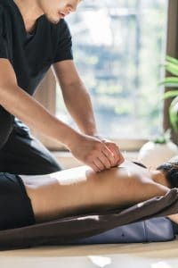 patient receiving acupuncture treatments on their upper back