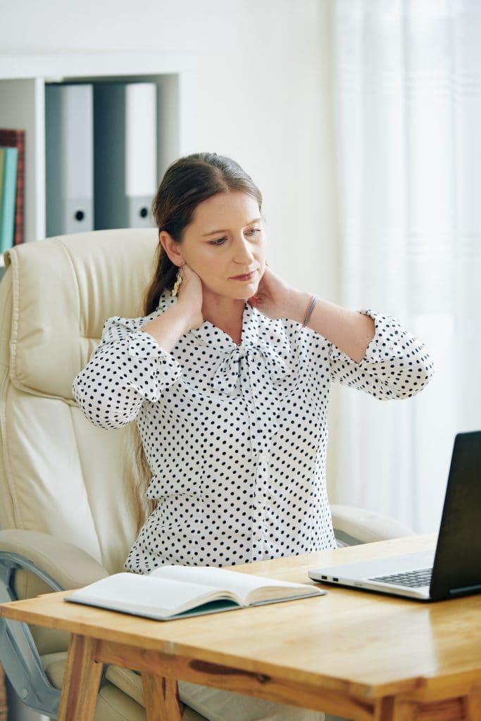 business woman having neck pain