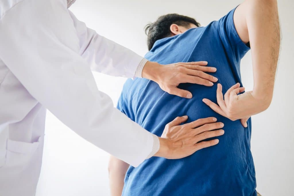 patient showing doctor his back pain