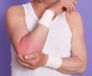 a man having pain in the elbow due to sports